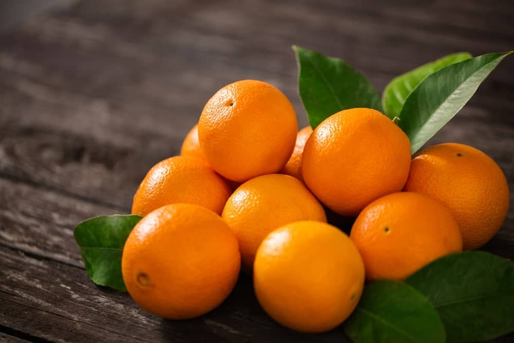 Oranges on a wooden background.