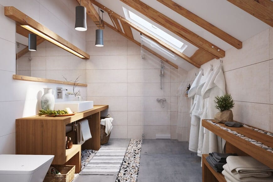 The small bathroom features wooden vanity and wooden countertop with marble basin sink on top. This room also features a high vaulted ceiling and wooden cabinetry.