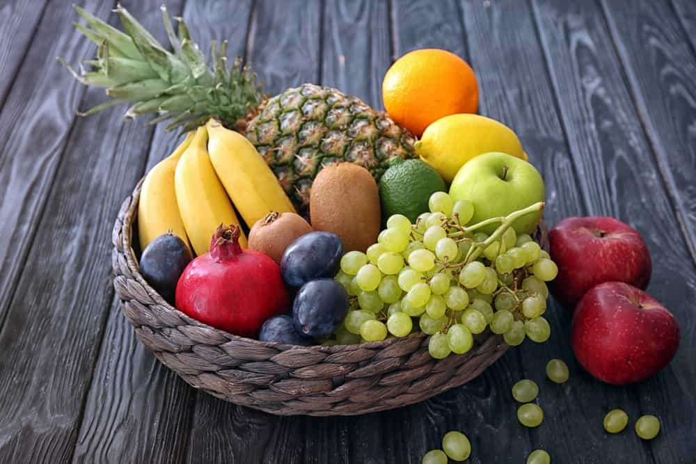 A rustic basket filled with different fruits.
