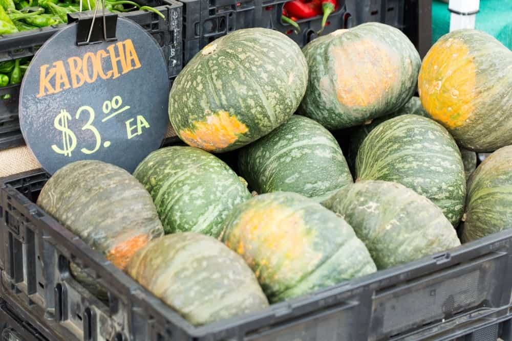 A bunch of kabocha squash on display for sale.