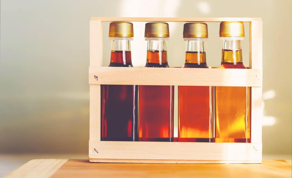 The four types of maple syrups in small glass bottles.